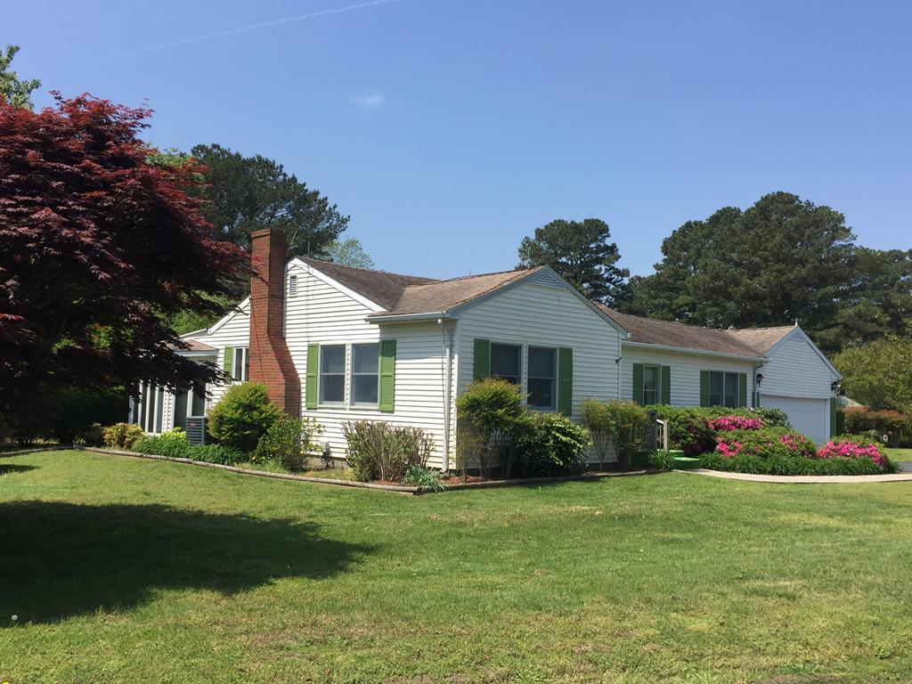 Well maintained home with beautiful landscaping.  All shutters are being painted.