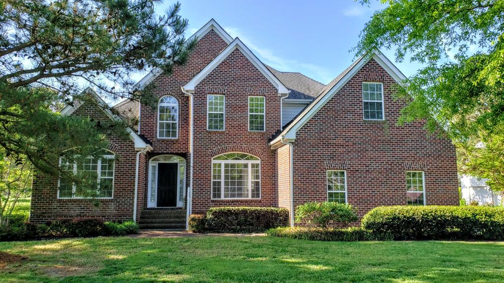 Convenient to the entrance of The Signature at Bay Creek, a spotless brick contemporary, 2800 sq. ft., in like-new condition featuring 4 BR, 2 1/2 Baths, attached double garage, landscaped grounds, golf cart access to private pool, tennis, beach, golf, boating, shopping, restaurants. House is fitted w/ special upgrades: architectural moldings & ceiling medallions, 18' vaulted ceilings in foyer & great room, oak hardwood floors, ceramic tile treatments, granite kitchen countertops, double vanities in both baths, glass shower/tub sliding doors, crystal chandeliers, bay windows w/ eyebrow tops, wood Venetian blind window treatments, walk-in closets in 3 BR, fancy built-in surround cabinets at wood-burning fireplace, eat-in kitchen w/ breakfast nook & southerly exposure over patio backyard