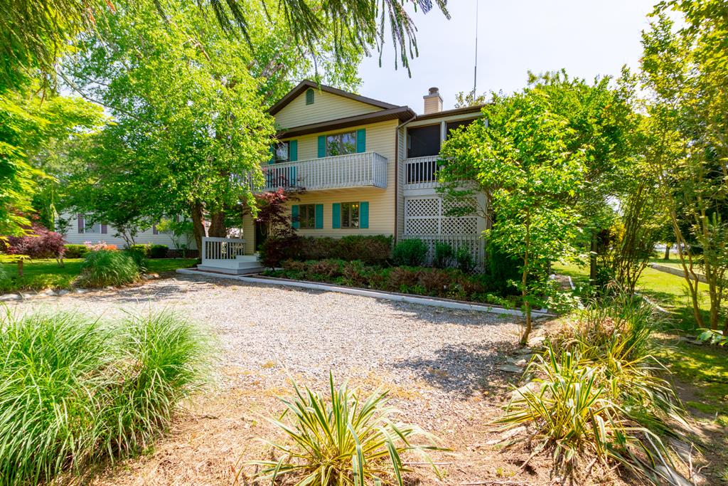 """This seaside home in the historic town of Wachapreague, known as the """"Little City By The Sea"""", makes a perfect vacation get-a-way or year round living. You will feel right at home in this small seaside community of less than 250 residents. You have a view of the seaside water on Finney Creek that leads out to the barrier islands and the Atlantic Ocean. This is the perfect sportman's location. Famous for inshore and offshore fishing, you will never feel crowded when strolling the streets of Wachapreague, lined with victorian-era seaside homes. Start living the coastal lifestyle on Virginias eastern shore!"""