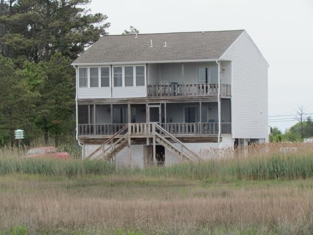 How would you like a front row seat to the Pony Swim every year...with no crowds, no fuss.  Here is your chance.  Located on the very same banks that the famous Chincoteague Ponies land after crossing the Assateague Channel.  This well maintained unit has two bedrooms, 1.5 bathrooms, one open balcony and one screened balcony.  Unit can be expanded for additional space.  Would be a great year round residence...or as a vacation home.  Includes your own community pier with a private boat slip.  Two car parking under unit.  Storage room also under unit.  This is absolutely amazing!!!  Waterviews from just about every window!  Unit sells fully furnished.  Appliances are two years old OR LESS and barely used!!!  Don't miss out on this great opportunity!!!