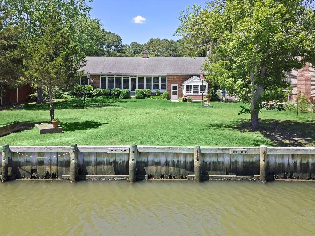 BRING OFFERS!Stately brick waterfront home overlooking Assateague w/ a large yard & breathtaking views. This ranch style home has a spacious kitchen that leads into a formal dining room. The counter space is abundant! The living room blends into the sunroom that has vast views of all nature has to offer.This home gives you the best scenic views. On the 1st level there is 2 spacious bedrooms & plenty of storage space throughout the home. The 2nd level is fully equipped apartment w/ a bedroom, bathroom & fully equipped kitchen. Off of the apartment bedroom, you will find an enormous attic that you could convert into additional living space. Gardeners will find this home heaven w/ an attached greenroom of the rear of the home. MOTIVATED SELLERS