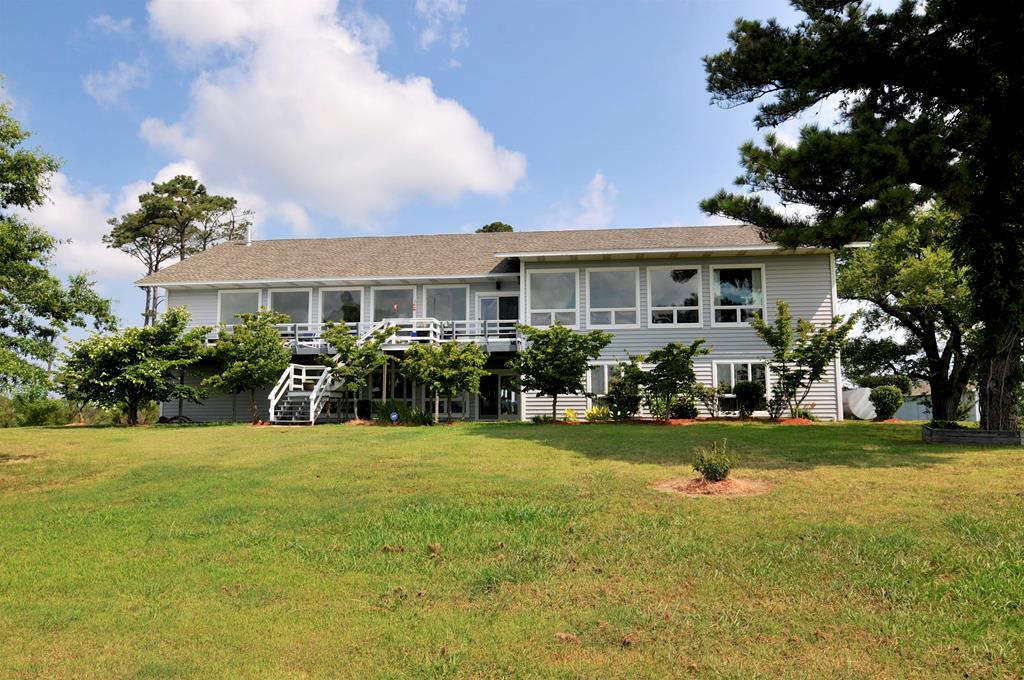 Stroll through this Waterfront retreat on the virtual tour. 89.26 Acres of privacy. 2 beaches, long dock with deep water!  6 bdrms, 6 full baths and 2 half baths, in almost 7000 square feet of gorgeous living space. Elevator for your convenience. Elevator accessible from garage. Windows and views galore.  Beautiful sunrises and sunsets! Large and redone modern kitchen. Huge Master bath. Unbelievable family room on first floor with wet bar.  Other rm 2 is bdrm 4.  Bdrm 5 is 23.5x16.  Bdrm 6 is 20x10. Storage room is 20x11.  Garage and elevator accessible from family room. 360 Degree view from the main house. Very private.Oyster leases may be available. Must see! Take a minute and enjoy the virtual tour. Perfect retreat or short term rental.