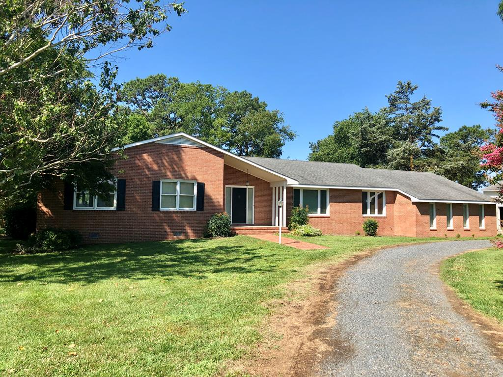 Let's get straight to the point. 2 separately deeded lots, totaling just over 2 acres. Waterfront, on a branch of Nandua Creek w/ direct access to the Chesapeake Bay & 600+ feet of shoreline. Southwesterly exposure. 20x60 Barn, w/ concrete floors, electricity, water, workbench, lean-to & 10ft doors. The house itself is just over 2600 square feet & set up as a 4 bedroom home. There is a 2 car attached garage w/ attic storage above. Mud/Laundry room has a full bath, & storage cabinets/closet. Oversized sunroom w/ panoramic views of creek. Formal living room & dining room, in addition to the eat-in kitchen, & family room. Owners suite includes double walk-in closets, & private bath. Other features: wet bar, 3 zone heat pump, new carpet in BRs, HW floors, wrap around deck, fireplace. Must See!