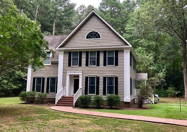 Located on a 3 acre wooded lot in the waterfront community of Red Bank, this well maintained home offers 3 full baths, custom built kitchen cabinets, and originally built by Tom Young for his daughter.  Structurally and tastefully built to say the least.  The two spare bedrooms are spacious and have lots of closet space, the owner's suite has his and hers closets and a Jacuzzi tub with separate hot water heater.  The kitchen and separate dining room welcome all your special guest.  HVAC few years old, freshly painted shutters, new brick sidewalks and fire pit.  There is deeded water access with a community dock.