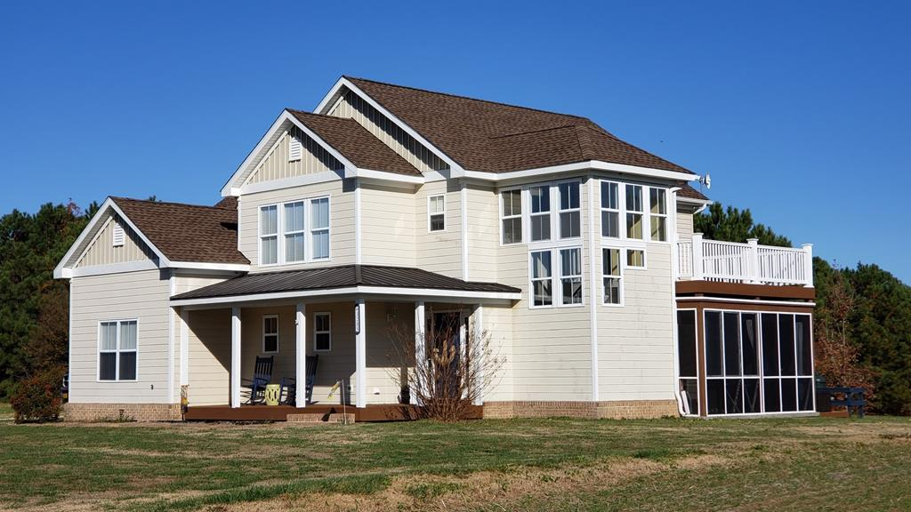 Near the historic Town of Cape Charles, a custom-built contemporary overlooking a scenic freshwater pond. This low maintenance house is a towering presence in Tower Hill, featuring Hardy plank siding, energy efficient window systems, 4 ceiling fans, custom 3 stage water filtration system, security system, 20' high vaulted ceiling in LR with floor to ceiling window wall facing north for perfect natural light for artists, hidden pantry in custom kitchen, beautiful cabinets with Corian countertops/tile backslash & 8' breakfast bar, 12'x16' screened porch & 12'x16' 2nd story sun deck, two sets of French pocket doors, attached 20'x22' garage, 3 y.o. architectural shingles on roof, 80 gal. hot water heater, master suite with twin walk-in closets and 8'x12' bath with separate shower & jetted tub.