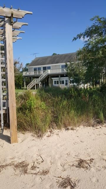 Turnkey Onancock Beach Cottage at the Crystal Beach Colony. Private waterfront village of 9 cottages. 4.5 miles from town. Live on top in modern floor plan, open kitchen, dining, living room. Owner's suite, luxury bath, screened porch, upper deck & half bath. Separate old school 50's Cottage below, w/long time rental history. 180 degree views into the Chesapeake Bay, see the lights of Tangier Island at night. Storage shed for beach stuff, kayaks, etc. Parking below. White, hard bottom, sandy beach, great for swimming. Boat ramp 1.5 miles away. Excellent fishing and crabbing, miles of uninhabited beaches. 1950's Chic Cottage below, Contemporary coastal living above. New septic upgrades 2016. Underground gas tank for heat,  fireplace & outside grill.