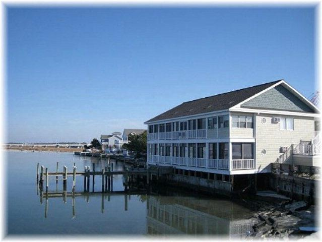 Priced below assessment.  Priced to sell.  Beautiful views of the Chincoteague Bay and Chincoteague Island.  Quiet area.  Enjoy the wildlife.  Boat dock is included in your ownership.  Updated floors.  Most furniture conveys.  Great for year round use or vacation use.  Could also be a vacation rental.  You owe it to yourself to consider this option.  Make sure your agent includes this property in your list of properties to view.