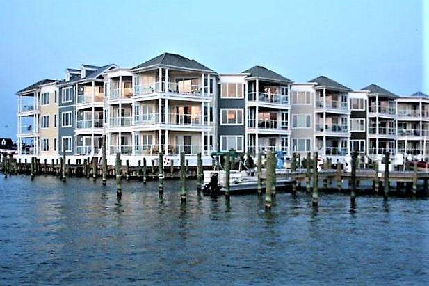 Luxurious Waterfront Condo boast 180 degree Panoramic views of the Chincoteague Channel. Catch the year round beauty of the Famous Chincoteague Sunset from 2 west facing balconies. Beautifully appointed & professional designed, this property would make an excellent second home/vacation rental with a rental potential of $1700 to $1900 a week. Living room offers wonderful open floor plan with gorgeous floor to ceiling windows and exotic Brazilian cherry hardwood floors. The kitchen features black Emerald Pearl granite and maple spice cabinets. The 18 x 13 main bedroom features a tray ceiling, private balcony, on-suite w luxurious deep jetted tub, tiled separate shower & his/her closets. Amenities include pool, fitness center&climate controlled storage unit... Ask about adding a Boat slip!
