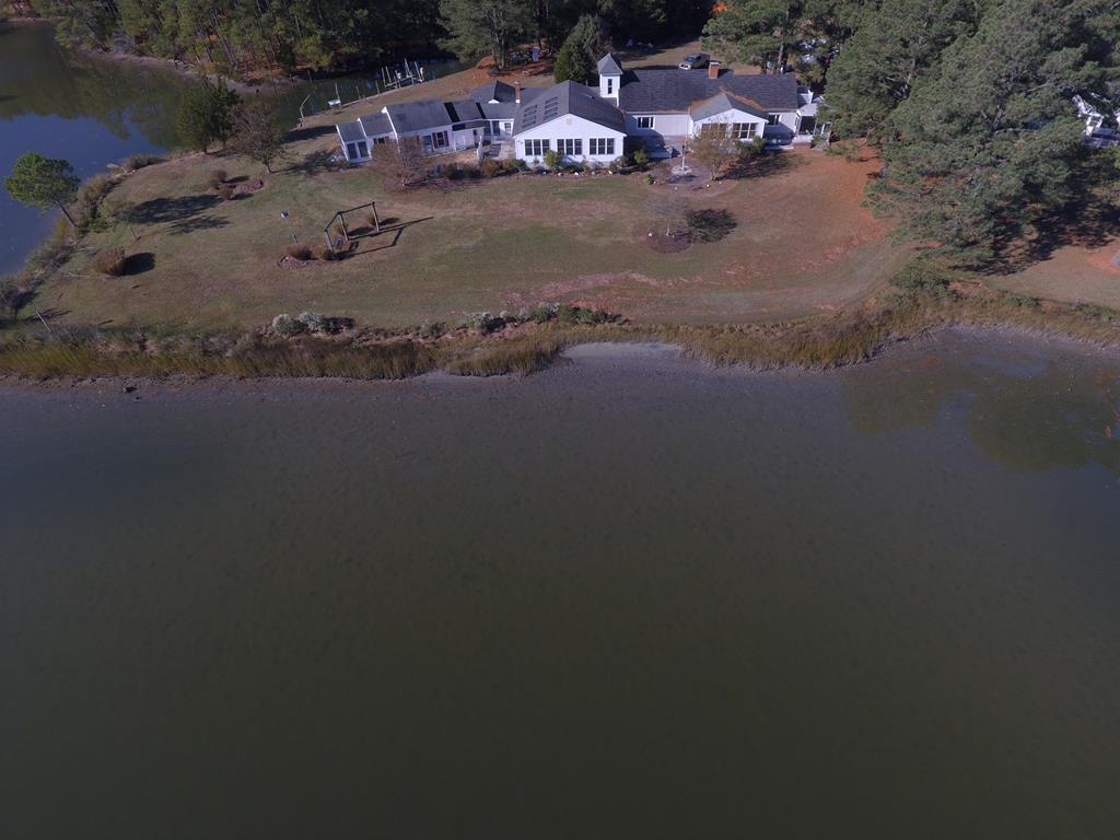 OPEN HOUSE 12/8, 1:00 - 3:00. Unique waterfront home located just outside Onancock on Parker Creek awaits creative new owner.  Property features a heated indoor pool, complete with Jacuzzi and swim jets.  2 fireplaces.  Approximately 500 feet of creek frontage plus a safe harbor boat basin with 2 jet ski lifts, boat lift and launch.  30 x 40 utility building featuring 4 vehicle bays. 5 bedrooms, 3 1/2 baths, 2 kitchens and several multipurpose rooms.  Property consist of lots 1, 2, 3 plus 1.1 acre adjacent track for a total of 4.4 (+/-) acres with beautiful unobstructed water view.  Priced below assessment.