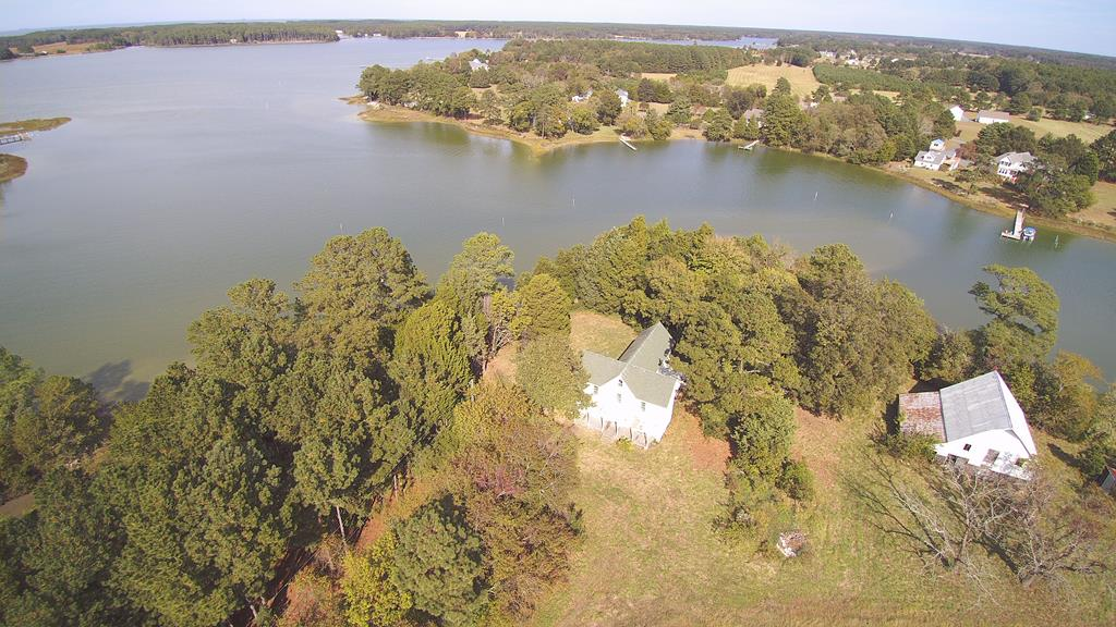 This classic Eastern Shore Farm House is nestled close to the waterfront.  A find for anyone interested in an ideal retirement home.  Perfect for farming, horses, livestock, hunting, or just for those who want to have a whole lot of space.  Not far from the mouth of the creek.  You can boat and fish, leaving right from your back yard.  The home is empty inside, with the outside painted and roofed.  New windows installed.  This house awaits a new owner to complete it, as they wish.  Large barn is in pretty good shape, as well.  Check out the videos, and set up an appointment to view the property.  3 bedrooms, 2-1/2 baths is an estimate, as the house is gutted and septic is original. 3D tour: https://my.matterport.com/show/?m=H8m188XBnxp&mls=1       Drone video: https://youtu.be/BQ2U9LWWZyg