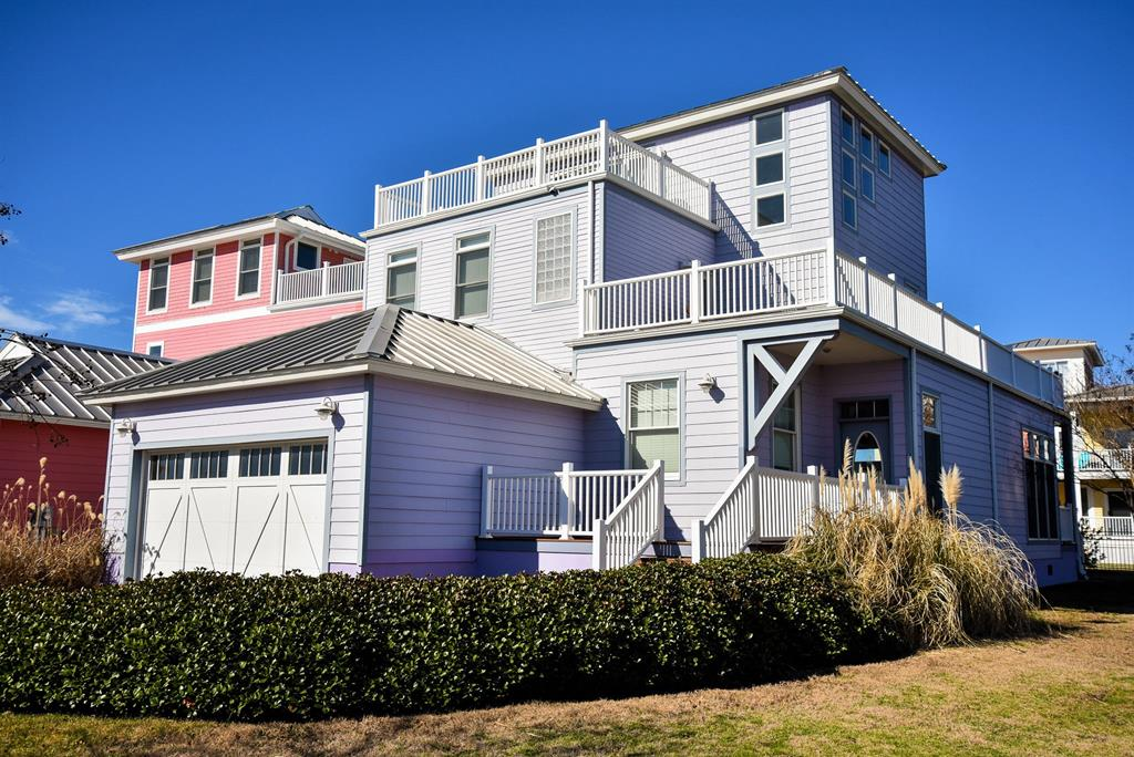 LOVELY CUSTOM BUILD & DESIGNED COASTAL BEACH HOME.This  well maintained 3000 sq ft home with metal roof and Hardiplank siding in lush island colors offers total first floor.living. Heart of pine floors, granite counter tops, updated stainless steel appliances and dual fireplace opens to the living area and outdoor porch.Third floor living suite is equipped with third zone heating/cooling system, private deck  bead board ceiling, wet bar, full bath and walk-in closet. Community private beach is close to your back door.. A world  class marina & fine dining  are just a few steps from you front door. Or, you can enjoy a golf cart or bike ride  into the historic town of Cape Charles or to the Bay Creek World class golf  courses, community pool, tennis courts. and restaurant.. . .