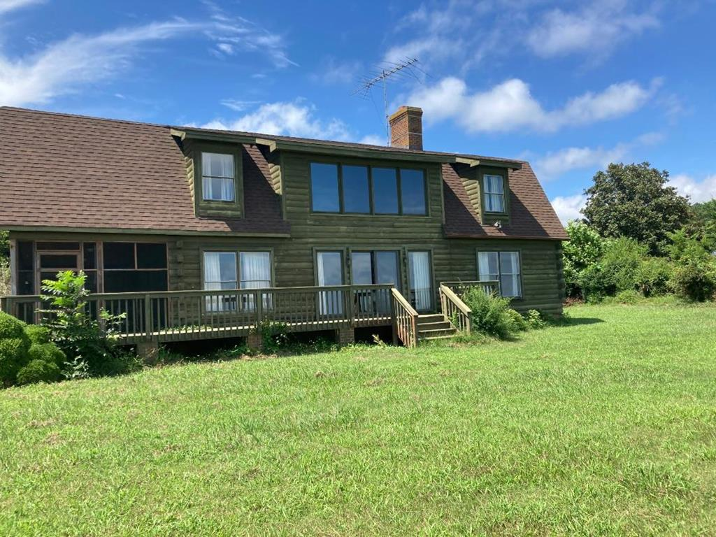 Enjoy sunrise views over Upshurs Bay and the Barrier Islands from your, 2226 square foot, log home. Set on 8.87 acres, home features open floor plan, two-story great room with fireplace and screened porch. First floor owner's bedroom with water view and en-suite. Bonuses include, two-car attached garage with large, unfinished bonus room and spacious rear deck. House is a Dutch Colonial style log home. Horse friendly location and less than 1 mile to Quinby Harbor boat ramp and dock. Less than 15 miles to Riverside Shore Memorial Hospital.