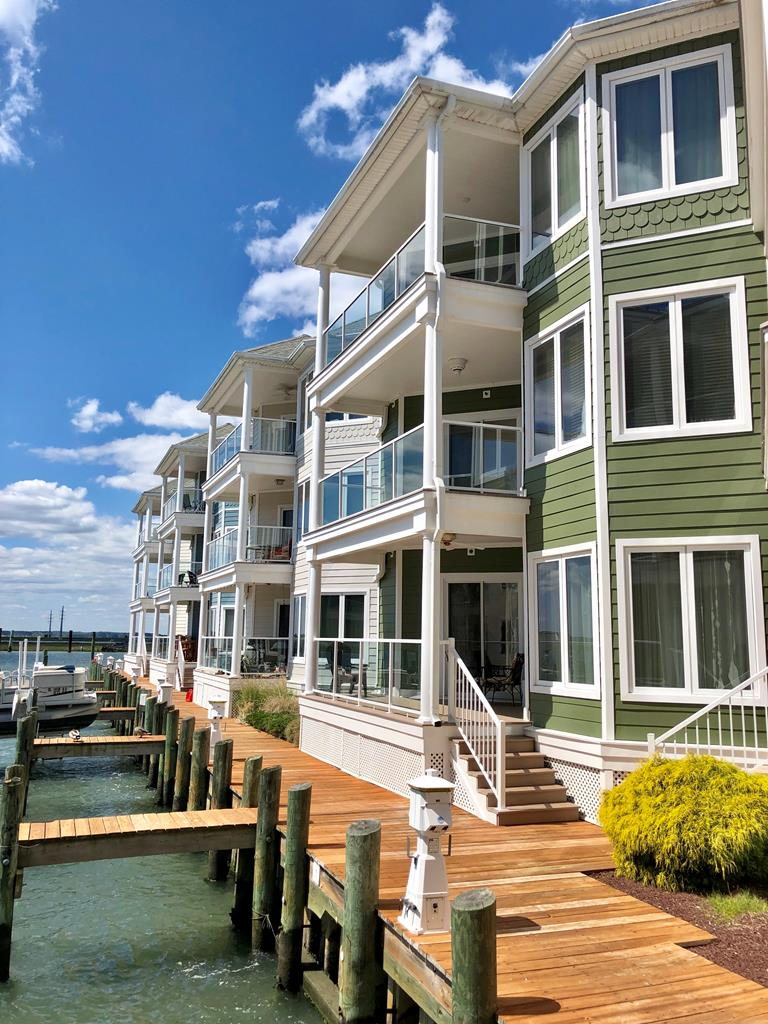 WATERFRONT, POOL FRONT & MARINA FRONT... IT DOESN'T GET ANY BETTER THAN THIS FOR ISLAND LIVING! Open floor plan as soon as you come in with WATERVIEWS! You will love the cabinets, Island with double sink, tile floor & dishwasher in the kitchen with nice dining space area to the side then spacious living room, hardwood floors and balcony access...smell the sea breeze! Incredible WATERVIEW in Master Suite, dual closet & full bath with jacuzzi tub & stand up shower. Two additional nice size bedrooms & tasteful decor. POOL STEPS AWAY! Large guest full bath with tile floor. Ceiling fans almost every room. Washer & Dryer room. Successful rental, turnkey ready, income helps with the mortgage & HOA fees! Located on the first floor for ease. FULLY FURNISHED, PRICED TO SELL & BREATHTAKING SUNSETS!
