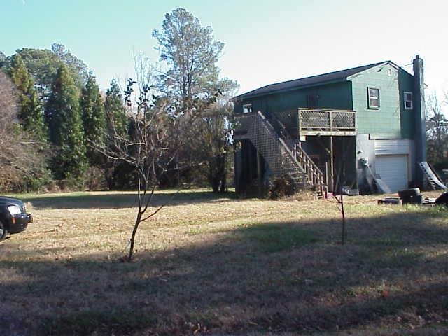 This 2 BR home is raised with an above ground 30x20 cement block basement with 14 ft ceiling , great for storage of boats and RV.  It is located on Lot 2 of the subdivision and is on the creek leading to the Chesapeake Bay called Deep Creek and just a few miles from Onancock which offers a theater, performing arts playhouse, and much more.  The lane leading to the home from Mink Farm Rd is gravel and the home is waterfront.. The location is very private,  Two adjoining lots, # 3 which is 5.5 acres and #4 which is 6.6 acres.can purchased at $70,000 each.