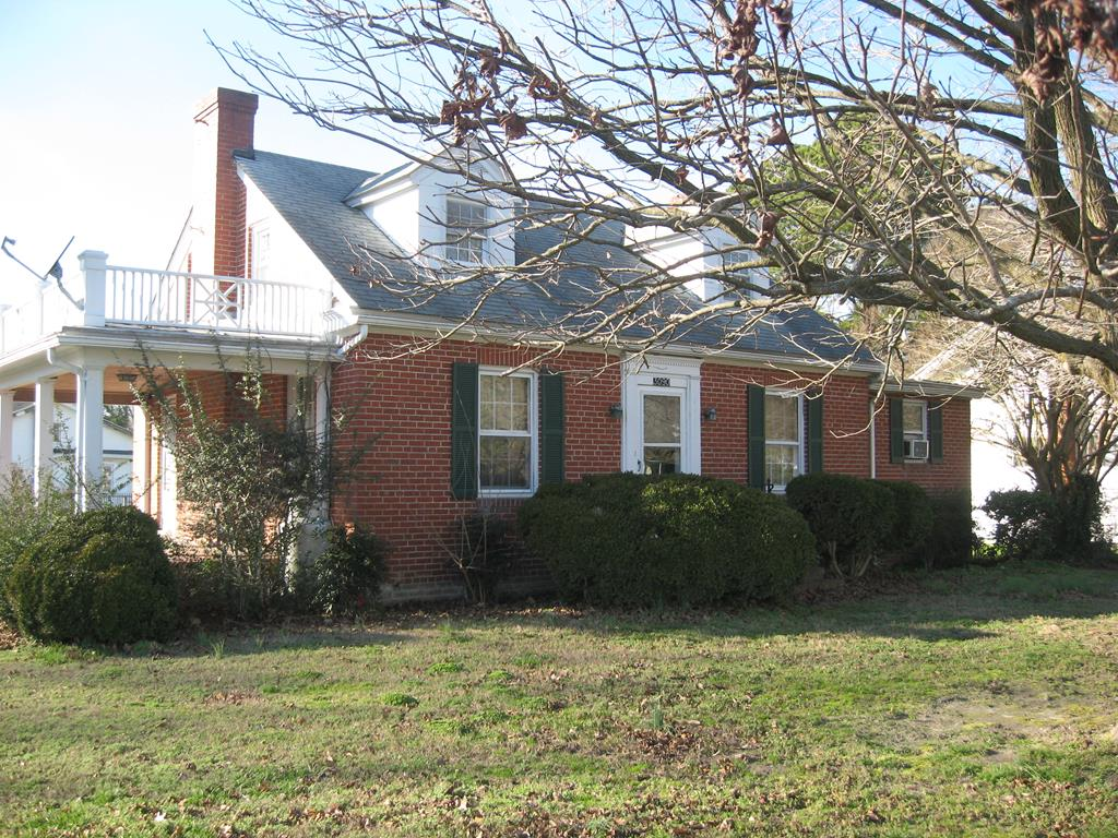Cute brick home on corner lot in the town of Exmore. Two bedrooms and full bath upstairs, bedroom with half bath downstairs.  Gas log fireplace in Living Room. Large open porch off the living room. Small room between the utility room and garage could be used as an office or for storage.