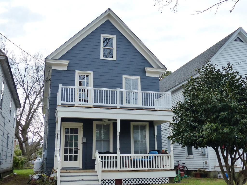 A 1920 historical home located within the Historic Cape Charles of the Eastern Shore of Virginia. You will enjoy sipping a cold tea on one of the porches or on the beaches of the Chesapeake Bay merely three blocks from the door step. This property captures the local charm of Cape Charles while also featuring art and textiles from throughout the world. The spacious  more than 2,000 square feet - accommodations include four bedrooms located upstairs and two full baths. The master bedroom gains access to the 2nd floor deck.  The 1st floor features front reading room, a middle entertainment room for lounging, a formal dining room, and an open kitchen.
