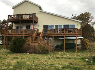 A seaside retreat to experience the best the Eastern Shore of VA has to offer. This home is situated with only a few other houses at the end of a private lane on over 3/4 of an acre directly on Metompkin Bay with panoramic views of the bay, barrier islands, and ocean. An excellent pier for boating and fishing. Decking that stretches the whole length of the house and upstairs balcony area both provide startling sights of the wildlife and setting. Large ground level garage is huge with ample parking space and/or storage capacity. Next level has main living areas.  An open concept kitchen anchors an excellent living room space with onebedroom on the main level, another two bedrooms on the top level with another two room with multiple use options. One currently setup as a bedroom.