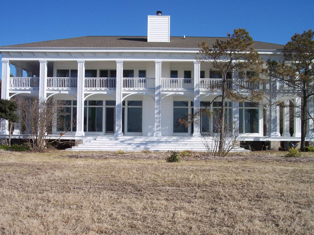 This Georgian Plantation home was built as a beachfront palace with sunsets in mind. Over 4000 sq ft with the Chesapeake Bay at your door step. 4 BR's/3.5 BA's are protected by bulkheading and granite boulders right next to the beach.  Upon arrival at the gated entrance you will travel through the woods on your asphalt driveway to a brick walk through the garden statues to the house.  As you  enter the double leaded glass front doors you are greeted by an grand open floor plan that includes the Dining room,living room and kitchen in a space that is 60' long and 22 ' wide. The floor is tile and the entire West wall is made of 10 tall windows that provide you a magical view of the Chesapeake bay. Your only visitors are Bald Eagles and Ospreys. Showings available by appointment.