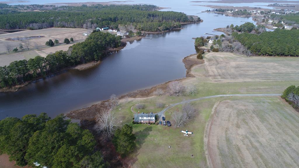Tucked away and nestled along Hunting Creek is this hidden gem, a charming Cape Cod featuring views of the creek with lots of waterfowl, deer jumping and running around the yard & field. Part of this property has an airstrip for landing a small plane. You are just a short ride from the public boat ramp around the corner if needed.  This property gives you the privacy you want and deserve. If you need a first floor bedroom this home has it.  Spacious yard with plenty of room for outdoor activities. This property is about 15 minutes give or take from the hospital if needed along with shopping, restaurants, galleries, local playhouse with seasonal productions, and movie theater. If the outdoors is your passion the shore has many creeks and coves to explore, ready for fishing and boating.