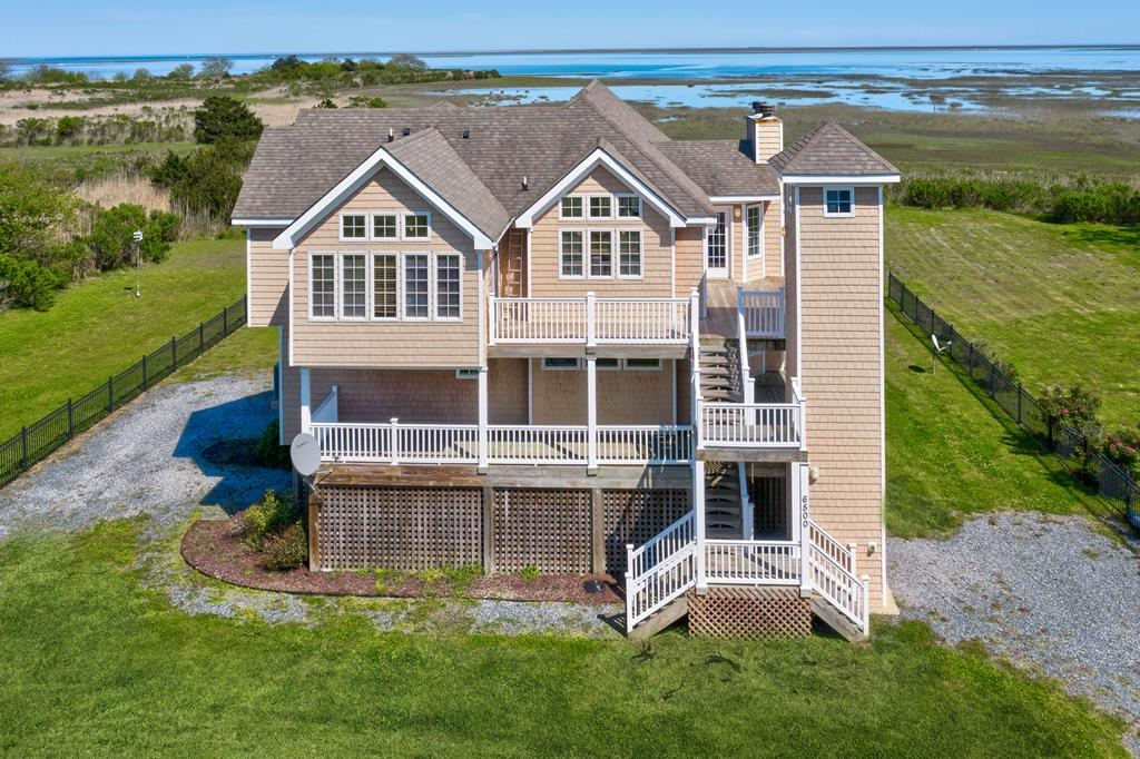 Modern Seaside Contemporary on pilings with expansive waterviews of the beautiful seaside of the Eastern Shore of Va. Elevator access.  Launch your kayak in your back yard and take the Kayak Trail north or south in protected waters. Home features reverse floor plan with the living area and kitchen on the top floor to enjoy the view.   Exterior steps to wide decks that circle the exterior to enhance your viewing pleasure. 3 BR's and 2 full and 2 half baths. Granite countertops, jetted tubs, tile floors, fireplaces, stainless appliances,exposed beams, tongue and groove ceilings and waincoating, Nailite siding and so much more. Storage closet on ground floor. Just 35 minutes to Va Beach, 10 minutes to Bay Creek golf and Cape Charles beach, Shopping and Brown Dog Ice Cream store.