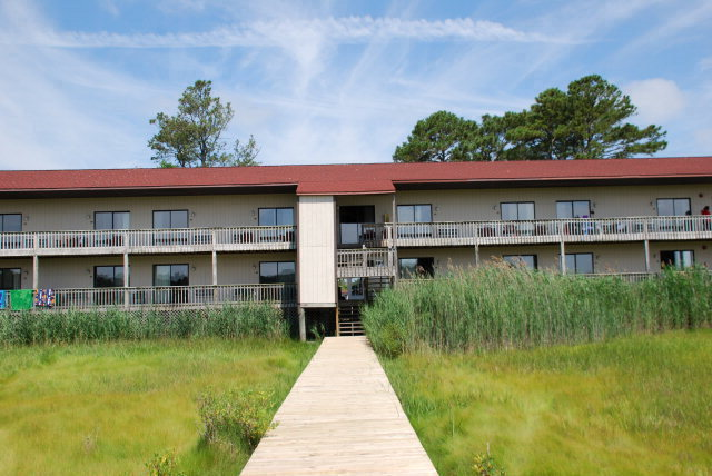 Cozy water-view condo unit located on the 2nd floor, Unit 209 of Assateague Inn Lodge. Units are rented on a nightly basis and there is a 24 hour on-site manager. Year round rental with many amenities including pool, storage area, pier, picnic and BBQ. Close to many Chincoteague attractions including the beach, stores, restaurants, mini-golf and go-carts. Condo being sold turn-key. Don't miss out you can have a condo by the beach at this low price.