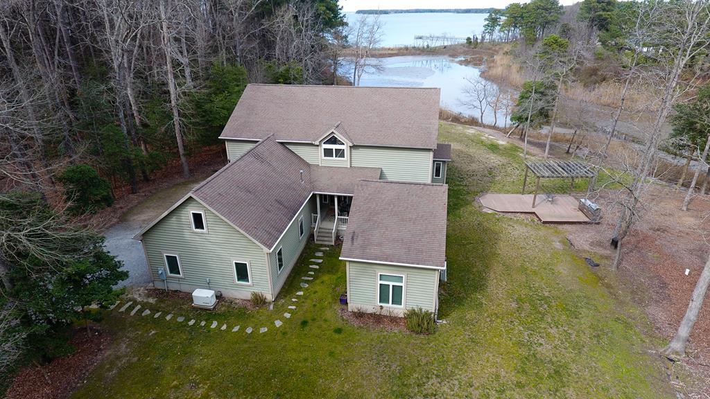 Looking for a high end architect designed home that features enormous windows with water views,Sunsets to remember, a Chefs kitchen with names like Jenn Air, Amanda, Fisher & Paykel, Thermador, High speed internet, smart home features,whole house wired  for electronics, security system, 16 KW Generator, Vermont Casting Wood stove, expansive Azek decks and porches, Owners quarters with deluxe en suite bathroom, Endless hot water system, Over 4200 sq ft inside on 9.75 ac craftsmanship abounds in this house,  2 car attached garage, large attached woodworking shop that any one will envy and can come fully equipped or with plumbing roughed in it could be an in-law apt, 45 min to Norfolk Airport, World class striped bass fishing minutes from your new home. It will exceed your expectations.  .