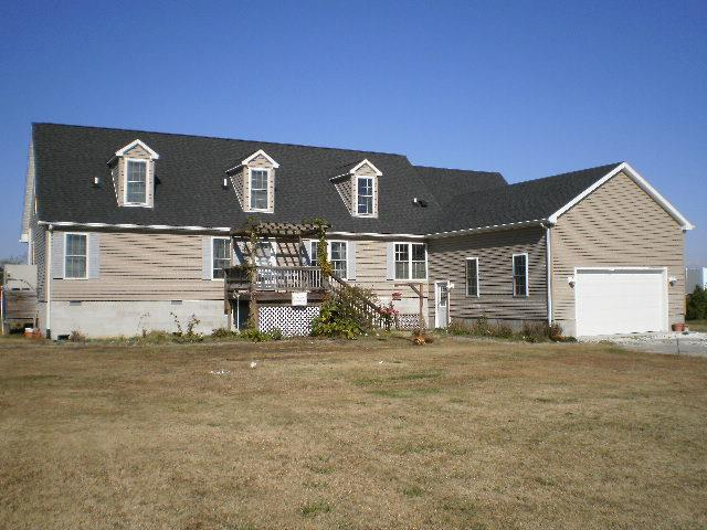 Looking for an affordable waterfront? On big,broad Nandua Creek leading to the Chesapeake Bay of Virginia, a 3100 sqft sits a custom home perfect for a vacation home or year round living in a natural country setting, with approximately 184ft of water-front. House features 4 large bedrooms, 3.5 baths, spacious family & Living rooms, all with water views, gourmet eat in kitchen with stainless steal appliances. Lovely wood flooring throughout the first floor. A 55' rear deck with covered porch over looking Nandua Bay, and a 12'x20' in ground swimming pool. This home is about 12 miles from Onancock where  you will find our new hospital, local dining&entertainment. Enjoy the pleasures of rural living but still be close to town necessities. Nuebeam is available for internet and phone service.
