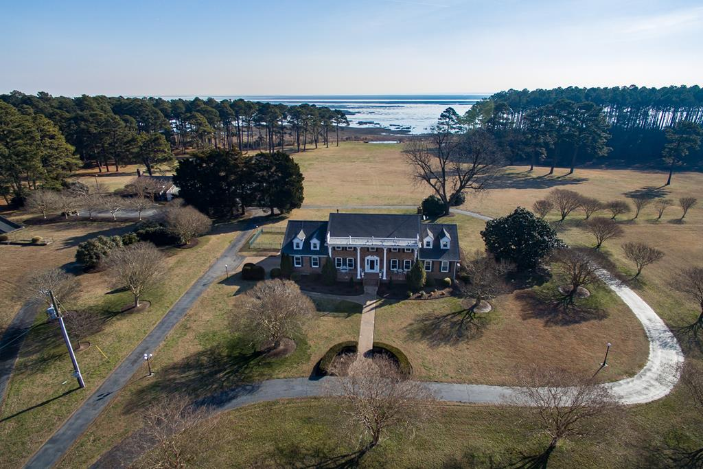 Private seaside farm with a main house - apprx. 185 acres on the Atlantic Ocean side w/views of the barrier islands. Located approx 10 mins to Cape Charles community (new development, residences, 2 award winning golf courses, marina & restaurants). Part of the land is currently leased for farming (approx. 70 acres). 3 wells for farming & 3 additional wells for house, pool & outbuildings. 7 acre fresh water lake stocked w/fish Approx 2150 ft of shoreline (marsh)-No dock or pier Structures: Main house-brick, 3196 sf, 5 bed/3.5 baths, 2-car garage Caretaker/guest house - 1048 sf, 1 bed/1 bath, rented $575/month Solarium w/indoor heated salt water pool 20x40; attached recreation/entertainment center with a commercial kitchen/dining area/gas fireplace. Well & septic; propane gas; Rinnai hot wtr