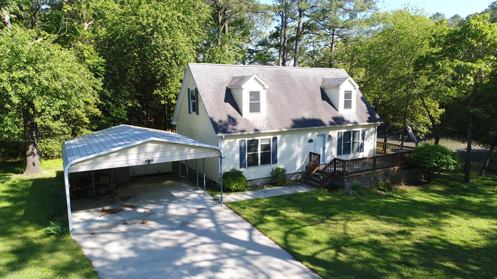 Beach, Boating and Relaxation! Wonderful waterfront Cape Cod, located right across the street from the Chesapeake Bay community beach with close proximity to the pool, tennis and boat ramp. Come enjoy the peaceful, quiet small community that offers some of the best fishing on the East Coast. Large living room with pellet stove, eat in kitchen, dining room/family room with waterviews. Home offers 3 bedrooms 2 full baths with space for office or additional sleeping area. Enjoy outdoor living space on front porch, back yard with outdoor shower. Vaucluse Shores is a friendly, active small community. Close to shopping, golfing and the Historic town of Cape Charles and the city of Virginia Beach. Come for a visit, you'll never want to leave! Sq.ft/room sizes and acreage are approximate.