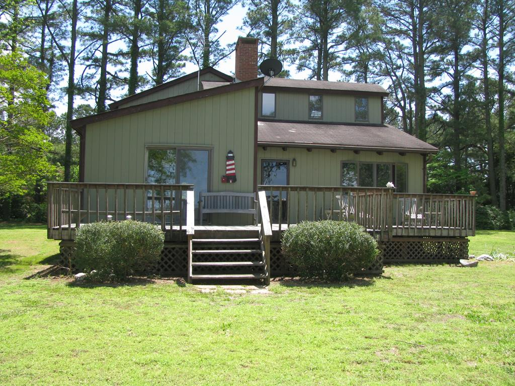 Concord Wharf: Little compound, 2 homes, on 3.8 acres with wide water views of Occohannock Creek.  Main house: 1,784 sq.ft., Kitchen, 3 B/R, 2 full baths, L/R dinning combo, Fire Place, hard wood floors, deck & basement. Second: 1,168 sq. ft., 3 B/R, 2 full baths, eat-in-kitchen, & deck.  Property has detached garage with workshop, barn, and other outside buildings. Adjacent to property is a 2+- acre cleared lot.   Grounds has mature pines, shrubs, & flowers but no obstruction from big water VIEWS from both homes.  Property has dock, crab house, and fabulous views of the creek and Chesapeake Bay.