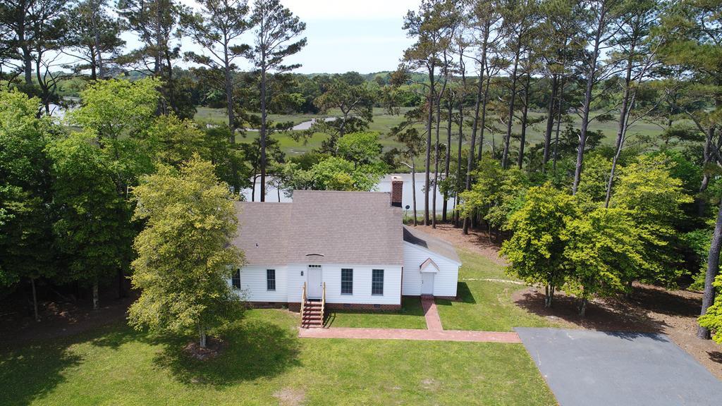 Come discover the Eastern Shore where you will find this Charming Seaside Cottage on White's Creek.  This is a great area for fishing, kayaking, bird watching and more. Relax on back deck while watching the wildlife pass by on the creek.  This location gives you the privacy you crave, but also allows you to the places you need like shopping, dining and more.  This custom built home could be modified easily to meet your needs as they change.  There is a detached garage on site to allow space for extra storage.  Plenty of the room in the yard for your pets to run, or have a garden.  There is a boat ramp just down the street, which makes it nice to go out for a evening ride on your boat.  So many things to do, so don't waste time, come on down before you miss out.