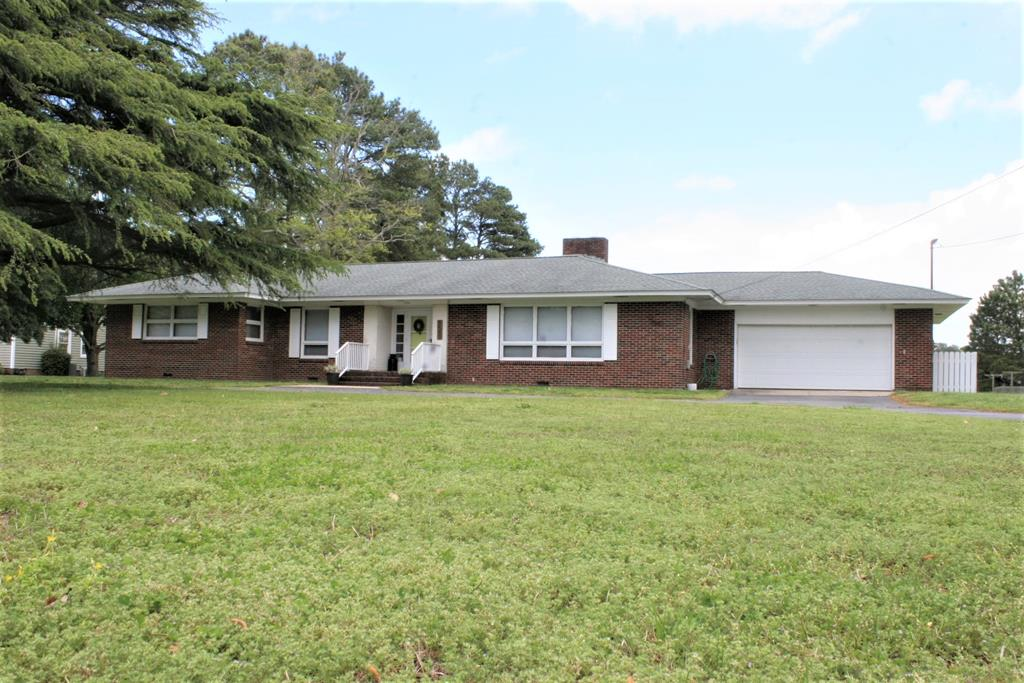 Take a look at this cozy mid-century modern brick rancher, located in Nassawadox, VA!  This spacious 2200 square ft., 4 bedroom 2 1/2 bath, single story home has plenty of space for any family.  Add in the huge lawn, attached garage, and enormous 80' x 30 ' detached garage/workshop in the rear and what more could you ask for.  The home has updated lighting, new paint, new dishwasher, and the kitchen was lightly renovated to open the space. This property is located just a short distance from shopping and dining in Cape Charles and Exmore, VA, as well as multiple boating and beach opportunities on Atlantic Ocean and Chesapeake Bay.  If you're looking for a great property with tons of space, storage for all your toys and projects, in the heart of  the Eastern Shore then house is a must see!