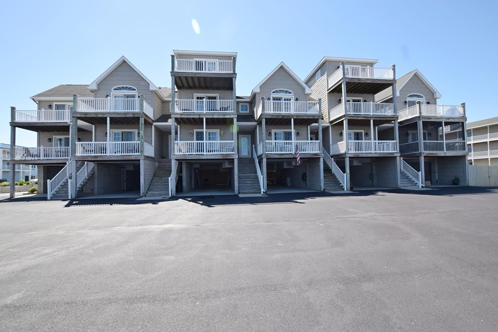 Like new, energy-efficient Townhome with Deeded Boat Slip. Direct water frontage being sold furnished by the original owners. Never a rental. Total of 550 square feet of decks: covered decks off living room and kitchen on the first floor, and an open sunset waterfront deck off the master suite and a sunrise deck off bedroom two on the second floor. Walking distance to the carnival grounds and downtown. Large 4310 x 123 garage, enough room for boat storage and parking. Two storage areas attached to garage, 6 x 12 with interior steps leading to the first floor and 6 x 8 area under the stairwell. Additional attic storage. Grilling area just outside the rear garage door. Watch the 4th of July fireworks display and rocket launches from the comfort of your boat, secured in Slip #3.