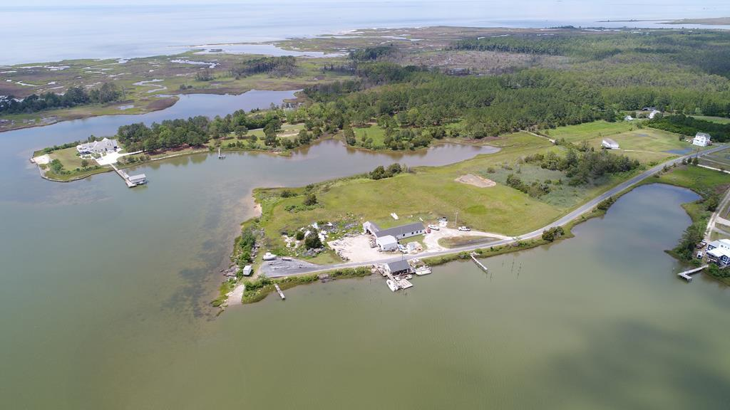 Own your own peninsula!!!  8 acres located on Nandua creek. This piece of property has over 2000 feet of water views and GORGEOUS SUNSETS!!!!  2 Docks, 2 septic systems,Property is currently used for agricultural business. But the possibilities are endless. Open a bait and tackle shop or perhaps build that forever home. Building on property has walk in coolers, ample Storage 200 amp electric service, and New office built a couple of years ago. Call your agent today for your showing.