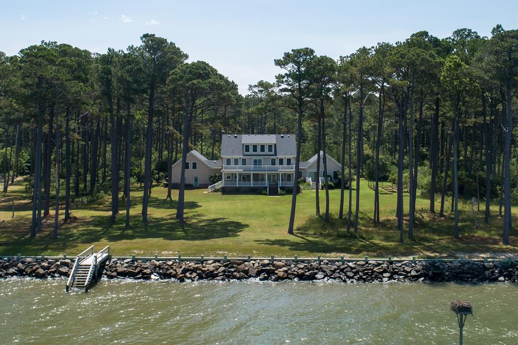 Enjoy expansive views of Chesapeake Bay from the large porch of this beautiful bay front home. The kitchen features maple cabinets, all electric appliances and two extra deep sinks. This house is handicap accessible, including a first-floor suite with full handicap accessible bathroom. Working elevator serves first and second floors. Large work room on the 3rd floor and finished room above the garage. Two walk-in attic spaces on the 3rd floor. Hardwood floors throughout with vinyl in FROG and 3rd story rooms. Standby generator and 400-amp service. Security system and propane heat serving multiple zones. Quality windows and low maintenance siding. Large master bathroom with jet tub, full bathroom serves two other bedrooms on second floor. Hardened bulkhead has been recently maintained.