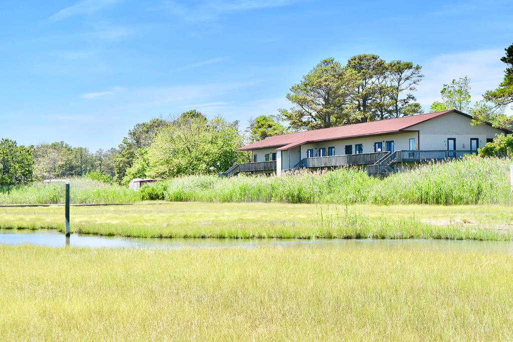Lovely Remodeled CONDO on the Creek! A wonderful NO MAINTENANCE Chincoteague Island Retreat! One CONDO separated into TWO UNITS or they can be opened up to one large unit . Great for more income producing rooms. Use one and rent the other... or use them both !! I love the options.  Two Bedrooms Toal and two full baths. Small kitchenettes. POOL, DOCK, Courtyard for Grilling, Crabbing, Fishing, the creek is good for a kayak or paddle board.  Affordable island getaway !    TWO one bedroom efficiencies with adjoining door. Completely Furnished and equipped right down to the dishes, pots , pans, flat screen TV, and morel  Dues include HO insurance, flood, electric, water, septic, pool, dock, cable, wifi, lawn maintenance and more..  Comes with a storage shed for your beach toys!
