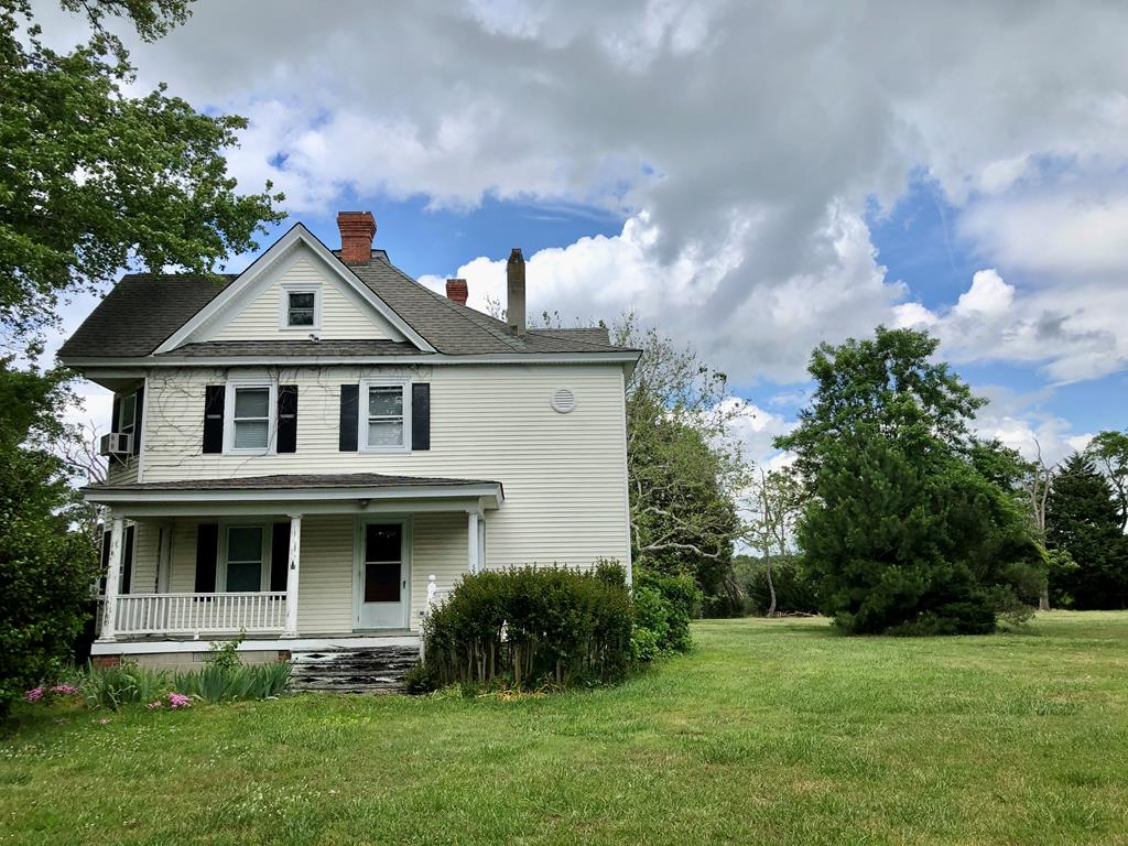 4.5 Acres on Craddock Creek. Very private location. Farmhouse is in need of repair - but appears to have good bones, and could be beautifully remodeled. Original pine floors are in great shape. Wide moldings. Spacious rooms. Other structures including a pool on property. Being sold as-is.