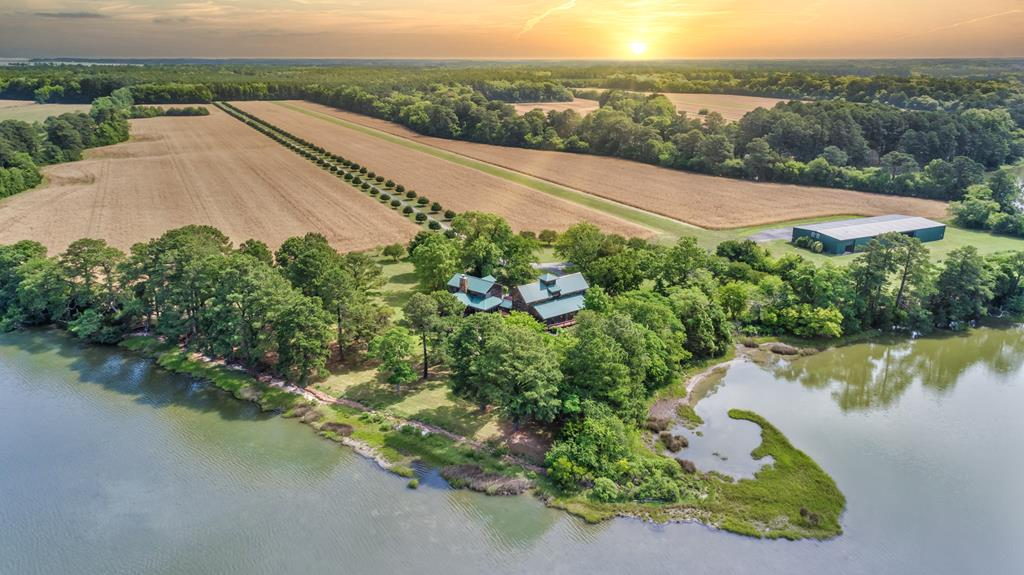 This 170ac farm is uniquely situated on the banks of a deep water creek leading out to the Chesapeake Bay. Designed as a family retreat compound by its owner/architect, this timber frame constructed home is the perfect get-away as a corporate retreat, bug-out compound, or working family farm. The 3600ft runway & 11,000 sqft hanger/workshop add to the accessibility & flexibility; just 1hr or less plane ride from Northern US Metro areas. Host large family gatherings and enjoy sunset water views from the large outdoor garden living space or from the comfort of the Hunt Country inspired sunroom. The dining hall seats 20, and the book lined library offers a cozy warm spot for conversation or just getting lost between covers on many subjects.