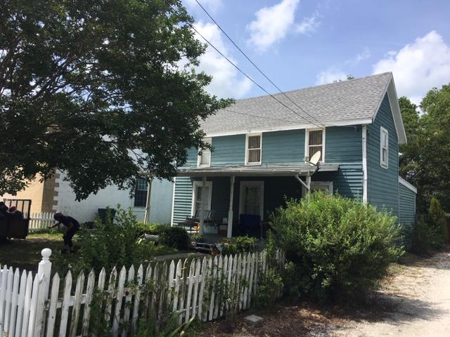 CAPE CHARLES HISTORIC DISTRICT TWO BEDROOM FIXER-UPPER!  Walking distance to downtown Cape Charles, Public Beach, and Harbor.  Steps from all retail and restaurants.    Central HVAC, new roof, great fenced-in front and back yard.  Close proximity to all Cape Charles has to offer!  This two story home is in need of some TLC.  Start your Cape Charles dream project today!
