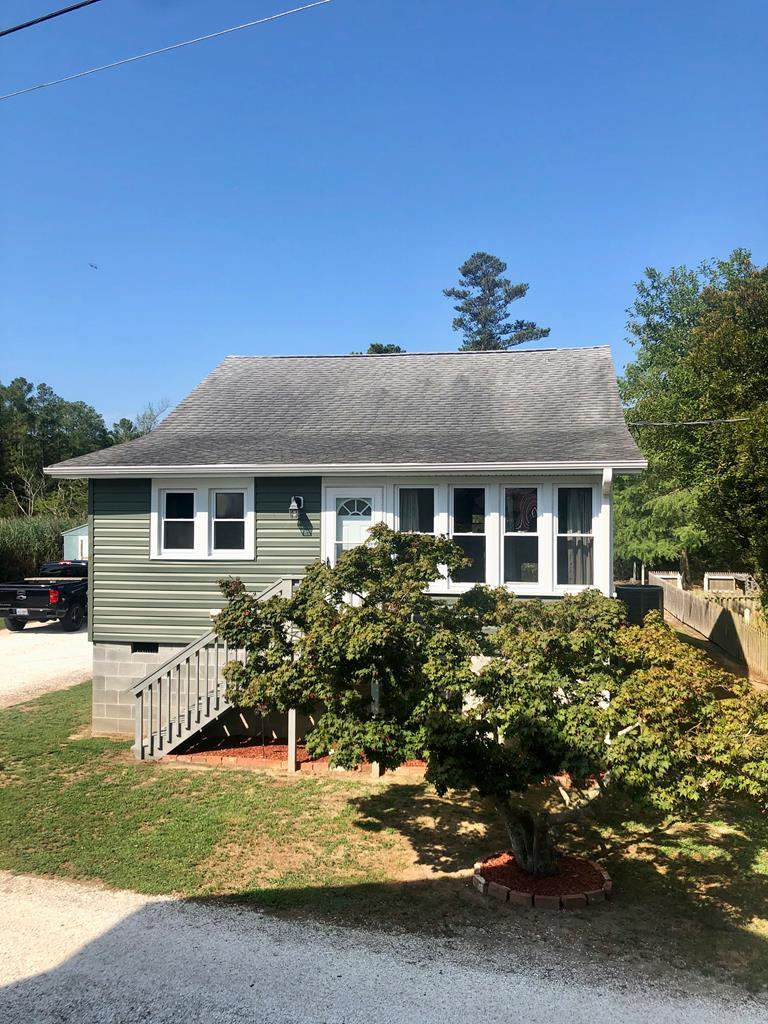 Renovated craftsman style bungalow in Deep Creek community just minutes from marina with boat launch, dock, storage and servicing.  Home has new wiring, plumbing, drain field, siding, insulation, HVAC, and flooring.  Enclosed sun porch. Located at the end of a quiet street, this property has a private backyard which includes 18.5 x 8 deck and two storage sheds.  Shelled driveway includes double carport. Ideal for a vacation home, investment property/VRBO, or starter home!