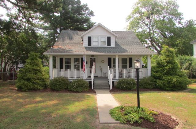 Buying a first home, retiring or just looking for that vacation getaway? This cozy, well maintained, home is settled in the town of Onancock and may just be what you are looking for! Explore the area with local shops, art galleries, restaurants and theaters. Home is around the corner from the public boat ramp where you can launch out and be on the Chesapeake Bay in minutes. Enjoy the views, fishing or crabbing. When you're done, dock the boat and enjoy a meal overlooking the creek at Mallard's restaurant. Attic is fully floored with lighting provided. The yard offers a front porch, the back offers a back deck, garden walkway and flowering trees. Onancock is a golf cart friendly town on Virginia's Eastern Shore. Property is located less than 3 miles from Riverside Shore Memorial Hospital.