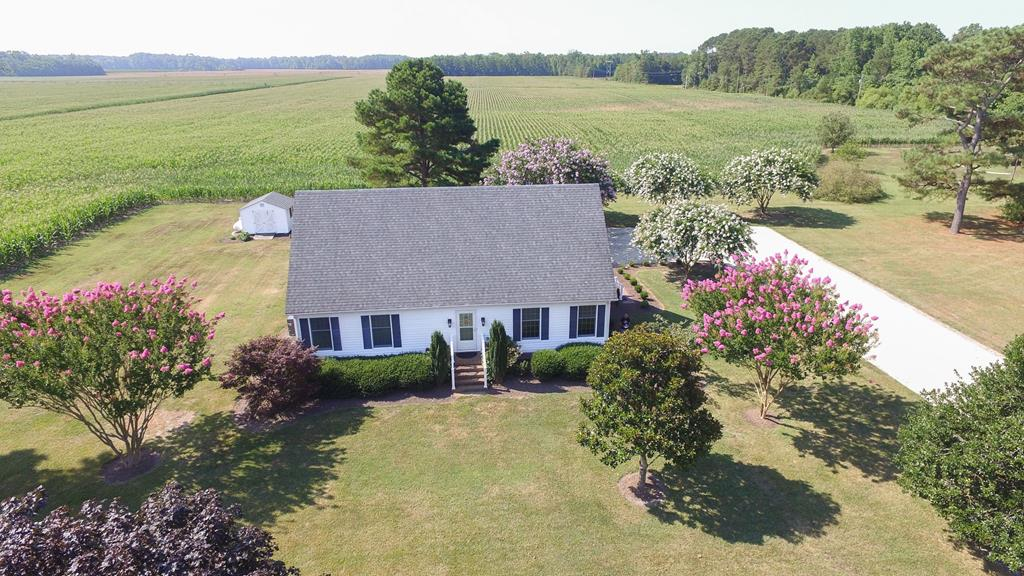 THIS BEAUTIFUL CAPE COD HOME IS LOCATED BETWEEN THE WATERS OF THE CHESAPEAKE BAY AND THE ATLANTIC OCEAN! This well maintained home with beautifully landscaped yard with mature trees is situated on 1.01 acres just outside the historic beachfront town of Cape Charles. This home offers an open concept floor plan with first floor master suite with large custom tile shower. Solid oak cabinetry, granite counter-tops, stainless appliances, gas range and Rannai tank-less hot water heater. Hardwood floors throughout. Large sitting room upstairs.  Enjoy the outdoors on your 16 x 20 deck and large brick patio. Just minutes to shopping, dining, marinas and the Oyster boat ramp to enjoy a day on the water on the seaside or just minutes to the Cape Charles boat ramp to access fishing on the Bay.