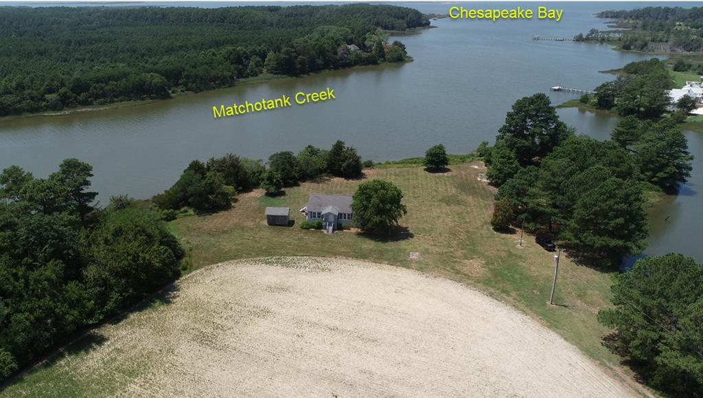 GET-A-WAY, RETREAT,  PRIMATY RESIDENCE or PLAYGROUND - 42.67 AC Farm on Matchotank Creek with approximately 2000 +/- feet of frontage on Matchotank Creek and the Cove.  The farm looks directly out Matchotank Creek toward the Chesapeake Bay for spectacular Sunsets.  According to a neighbor the water depth at low tide is app. 3 to 4 feet.  It is unspoiled and some areas along the Creek have Sandy Shoreline.  This farm has all the privacy and is only 15 minutes to town of Onancock.  The farm offers a wide variety of wildlife (Deer, Ducks, Geese, Turkey, etc.).  The home has been used very little and appears to be in prestine condition with an open floor plan.  Large Deck on the Back overlooking the Creek and a workshop and/or a storage building.  This property has unlimited opportunities.