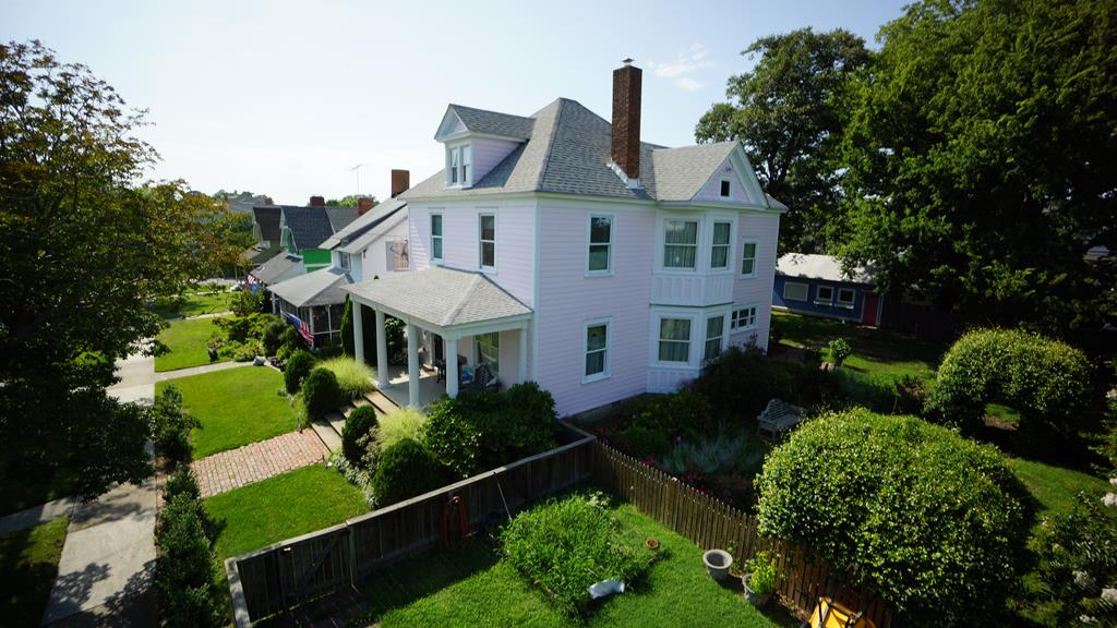 This gracious Cassatt Cottage is one of the first built in Cape Charles. Beautifully restored in 2006, Penn RR president Alexander Cassatt (brother of impressionist painter Mary Cassatt) built this historically protected gem in 1886. It boasts 3 Bedrooms & 3 Baths; high ceilings w/picture moldings; 8 baseboards&crown moldings; original wood floors; LR w/gas FP & original pocket doors; foyer w/painted mural & pocket doors; formal DR connects via Dutch door to all-wood kitchen w/soft-close hardware; breakfast room/study; walk-in pantry; mudroom; back porch; irrigation system; alley access & detached mancave-art studio to envy. One block from park yet walking distance to beach, restaurants, shops, galleries & more: A great forever home!