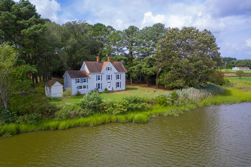 An  original waterfront  farm house on the shore of Chesconessex Creek with 163.21 feet waterfront along the creek.. You will find a bit of paradise tucked away from the hustle and bustle - what better a place to avoid the crowds.  And yet  Put in a dock into decent water.  Boat ramp just up the road and you will be minutes away from the Chesapeake Bay.  Throw out a couple of crab pots  enjoy picking those crabs! ,Jjust 10 minutes to Onancock with its restaurants, theaters, art galleries and shops. This blank slate of a home is ready for you to move into and it is just asking for your input.  Kitchen was redone a several years ago. Fireplaces in living room and dining room.  Views are breath taking.  Being sold as is.  Fix this home up to your own waterfront paradise.