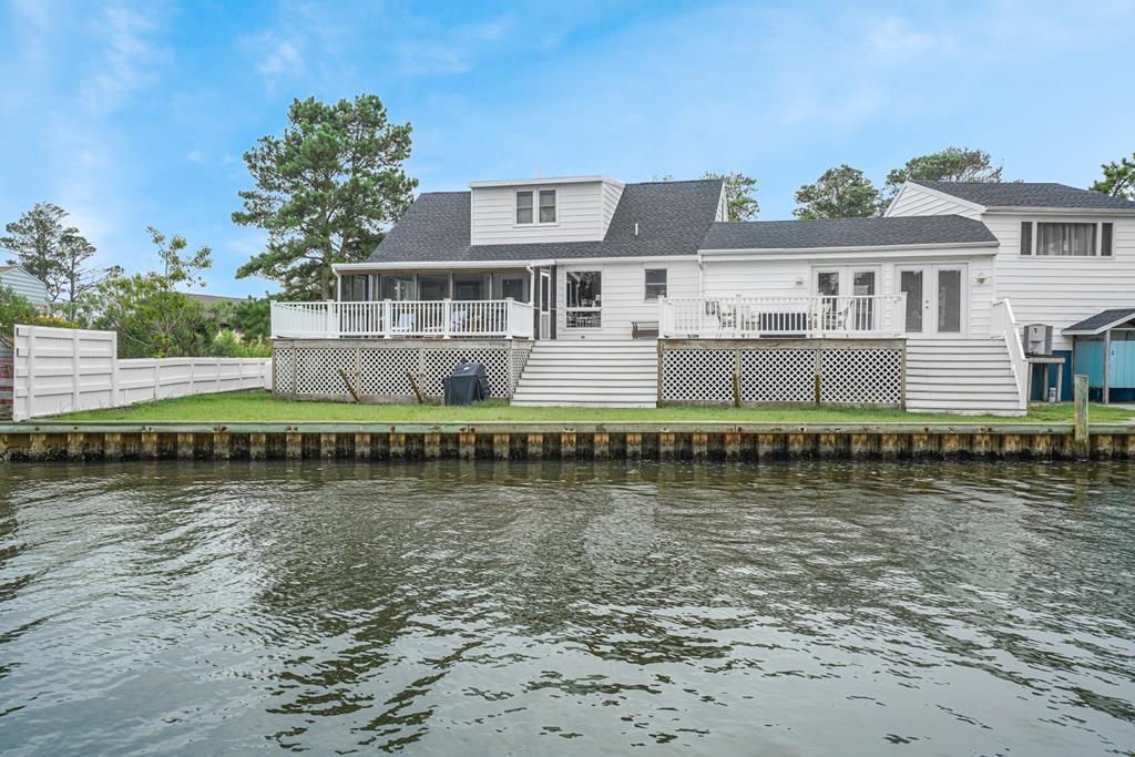 A TRUE ISLAND RETREAT-This beautiful coastal home offers a complete package of seashore amenities! The large 4+ bedroom waterfront home includes a separate & private guest suite/studio/home office overlooking the water. Dock your boat, launch your kayaks, throw the crab pot over and fish for dinner from your backyard! Inside you'll flow from one room to another with a well-designed (custom) floor plan & water views in most rooms. Enjoy cool evenings in the family room by the fireplace or entertain your guests in style from the open kitchen & game room which is flanked by a large screened porch with ample deck areas. With bedrooms and full baths on all levels, this home is perfect for that high-demand buyer that requires easy-living options. New roof in 2016. Most furnishings convey.