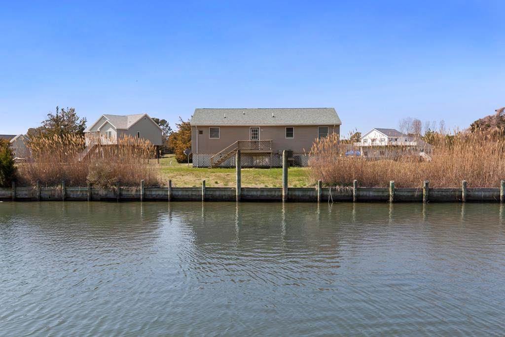 HUGE PRICE DROP! Adorable Canal Front Home in Captain's Cove waiting to introduce you to the Shore Life. This 3 Bdrm/1.5 Bath Home is cute & cozy, w/stunning Views of the Canal & a short run to Chincoteague Bay. Enjoy morning coffee as you watch the Herons & Egrets fish for their morning meal.In a water privileged community full of personality & amazing Amenities, it's a dream come true. Experience bay breezes from the large back deck and incredible sunsets. Open & airy Kitchen looks out over the Canal and opens to the Living Room, which is light and bright throughout. Recent Bathroom remodel. Tie your boat up out back - bulkhead in great shape. Perfect for 2nd Home, 1st Time Homebuyer. Captain's Cove Amenities include an Indoor Pool, 2 Outdoor Pools, Golf, Tennis, 24 Hr Security & more!
