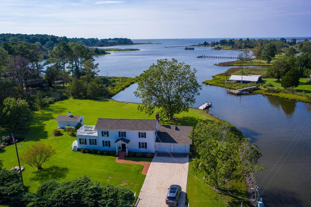 Spectacular waterfront property on a point on Hunting Creek.This point was the site of a Union solider encampment. Come sit where the these men sat with this unobstructed view of the mouth of the creek and Chesapeake Bay House was totally renovated about 7 years ago. Complete privacy and your own dock. First floor bedroom with a sitting room that is overlooking the water. Large great room with a fireplace with gas logs with sitting area, large dinning area and the perfect kitchen for entertaining. Large enclosed porch for dining or reading that best seller. 2nd floor has 2 bedrooms  and a generous bath. Off the southern bedroom, is a large deck where you can sit  sip your favorite drink and watch the sun set over the bay,  12+A wooded across the road, can be purchased. SEE VIRTUAL TOUR