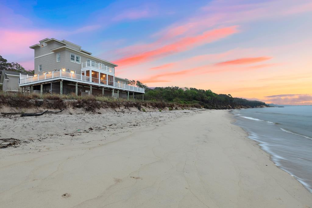 AUCTION: Bid Oct 22-26. Previously Listed for $1.699M. No Reserve. Showings Thurs - Sunday 1-4PM and by Appointment. Located just south of Cape Charles in the private, unincorporated community of Picketts Harbor, this Virginia Beachfront getaway is the ultimate destination for peace and relaxation. Panoramic views from the stunning wrap-around deck are unmatched and with nature conservancies surrounding the property, sounds of birds and waves of the Chesapeake Bay will fill your senses. Enjoy your morning coffee on the enclosed section of the deck and watch the sunset. This luxury home is just steps from your private white-sand beach. This is your perfect vacation home or year-round getaway at Waters Edge at Picketts Harbor.