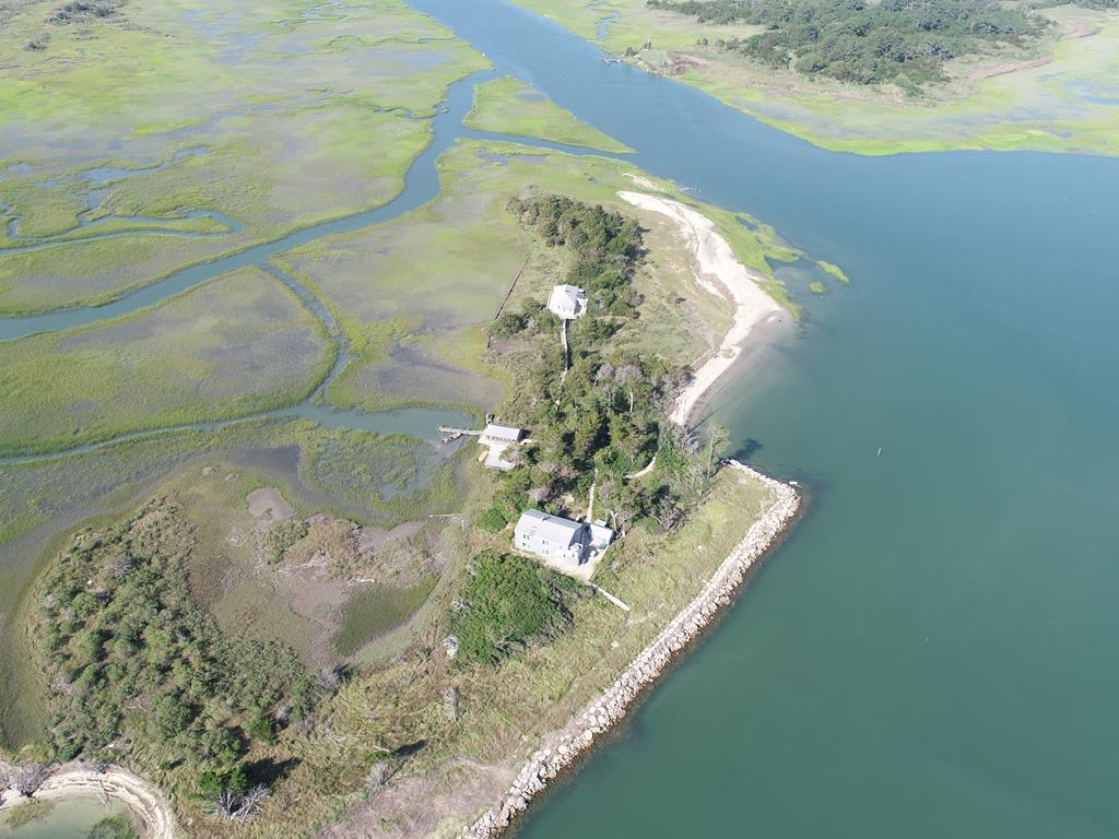 Island Living always been your passion or desire, well here is your chance. Located off the southern tip of the Eastern Shore of Va.  access only by boat via the VA Inside Passage.  Two homes each in good condition on 183 acres. The two story home has 10 Rooms on 2 stories with hardy plank siding and metal roof. with extensive decking and walkways to dock and 2nd home which is also 10 rooms on one  floor. Both homes sold furnished.  They have propane refrigerators and lighting as well as battery operated toilets and lighting.  Both are in good condition and are used infrequently. Beachcombing white sandy beaches, fishing and duck hunting have been the primary uses since the turn of the century. Boat Access to see this unique property is available. Plat, photos, & details available.